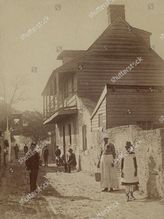 Street scene with a soldier, two African American women, and others in St. Augustine, Florida, 1886. Photo by George Barker
