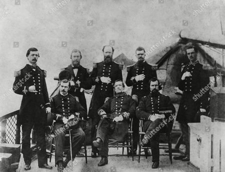 US Civil War. Officers of the CSS Sumter, a Confederate blockade runner and commerce raider. In April 1862, when the CSS Sumter was laid up at Gibraltar, this crew was reassigned to a new commerce raider, CSS Alabama. Seated, L to R: 2nd Lt. William E. Evans; Commander Raphael Semmes; 1st Asst. Engineer Miles J. Freeman. Standing, L to R: Surgeon Francis L. Galt; Lt. John M. Stribling; 1st Lt. John M. Kell, Exe. Officer; Lt Robert T. Chapman; and 1st Lt. Becket K. Howell, USMC