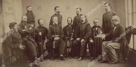 Stock Photo of Military commission that tried and convicted the Lincoln conspirators, 1865. Standing, L to R: Brig. Gen. Thomas Harris, Maj. Gen. Lew Wallace, Maj. Gen. August Kautz, and Henry Burnett. Seated, L to R: Lt. Col. David Clendenin, Col. C.H. Tompkins, Brig. Gen. Albion Howe, Brig. Gen. James Ekin, Maj. Gen. David Hunter, Brig. Gen. Robert Foster, John Bingham, and Brig. Gen. Joseph Holt