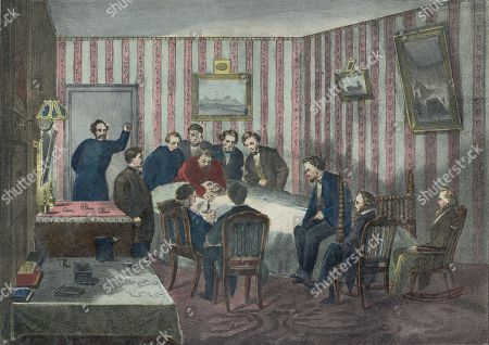 President Abraham Lincolns deathbed in the Peterson House, across the street from Fords Theater, is attended by his generals, cabinet, and his son, Robert Lincoln (sitting on the foot of the bed)