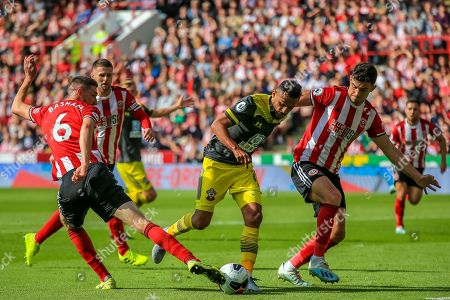 14th September 2019 , Bramall Lane, Sheffield, England; Premier League Football, Sheffield United vs Southampton ; Sofiane Boufal (19) of Southampton looks to evade John Egan (12) and Chris Basham (06) of Sheffield United