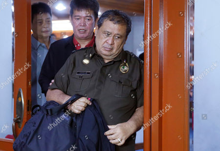 Bureau of Corrections official Ursicio Cenas is escorted to his detention after he and two other officials were cited in-contempt in the continuing Philippine Senate probe, in suburban Pasay city south of Manila, Philippines, on the failed release of former Mayor Antonio Sanchez who was convicted in the 1993 rape and murders of two students. The Senate probe has uncovered alleged anomalies and corruption over the release of hundreds of prisoners, including convicted rapists and drug traffickers, through a law rewarding good behavior in detention