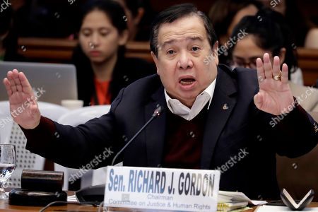 Senator Richard Gordon, Chairman of the Senate Committee on Justice and Human Rights, gestures during the continuing Philippine Senate probe, in suburban Pasay city south of Manila, Philippines, on the failed release of former Mayor Antonio Sanchez who was convicted in the 1993 rape and murders of two students. The Senate probe following a public outcry has uncovered alleged anomalies and corruption over the release of hundreds of prisoners, including convicted rapists and drug traffickers, through a law rewarding good behavior in detention. Three Bureau of Corrections officials were later cited in-contempt and jailed for an indefinite period