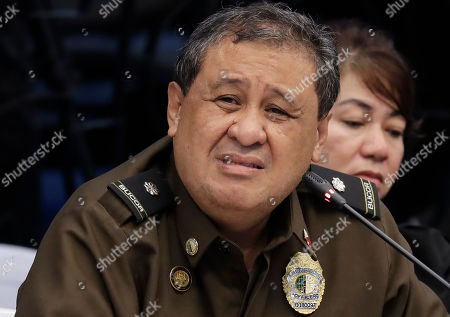 Bureau of Corrections official Ursicio Cenas reacts after he and two other officials were cited in-contempt in the continuing Philippine Senate probe, in suburban Pasay city south of Manila, Philippines, on the failed release of former Mayor Antonio Sanchez who was convicted in the 1993 rape and murders of two students. The Senate probe has uncovered alleged anomalies and corruption over the release of hundreds of prisoners, including convicted rapists and drug traffickers, through a law rewarding good behavior in detention
