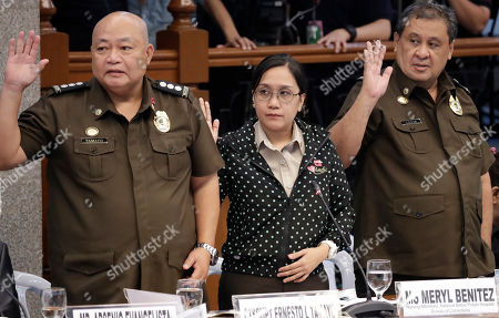 Ursicio Cenas, Meryl Benitez, Ernesto Tamayo. Bureau of Corrections officials, from right, Ursicio Cenas, Meryl Benitez and Ernesto Tamayo, take their oaths at the continuing Philippine Senate probe in suburban Pasay city south of Manila, Philippines, on the failed release of former Mayor Antonio Sanchez who was convicted in the 1993 rape and murders of two students. The Senate probe has uncovered alleged anomalies and corruption over the release of hundreds of prisoners, including convicted rapists and drug traffickers, through a law rewarding good behavior in detention. Cenas was later cited in-contempt by the Senate and jailed for an indefinite period