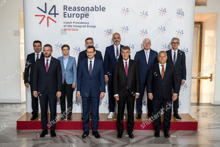 (Back row, L-R) North Macedonia Prime Minister Zoran Zaev, Prime Minister of Serbia Ana Brnabic, Chairman of the Council of Ministers of Bosnia and Herzegovina Denis Zvizdic, Albanian Prime Minister Edi Rama, Prime Minister of Montenegro Dusko Markovic, and Kosovo's Ambassador to Czech Republic Arber Vllahiu, (front row, L-R) Slovakian Prime Minister Peter Pellegrini, Polish Prime Minister Mateusz Morawiecki, Czech Prime Minister Andrej Babis and Hungarian Prime Minister Viktor Orban pose for photographers during the Visegrad Group (V4) and Western Balkan partners summit in Prague, Czech Republic, 12 September 2019.