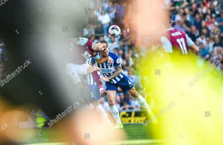 Jay Rodriguez of Burnley challenges Shane Duffy of Brighton as they are framed by the referee assistants flag during the Premier League match between Brighton and Hove Albion and Burnley at the American Express Community Stadium , Brighton , 14 September 2019