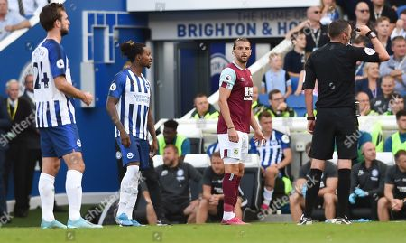 Gaetan Bong of Brighton eyes up Jay Rodriguez of Burnley during the Premier League match between Brighton and Hove Albion and Burnley at the American Express Community Stadium , Brighton , 14 September 2019
