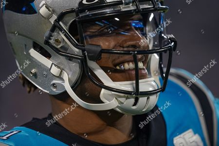 Cam Newton, Quarterback of the Carolina Panthers (1), smiles on the field