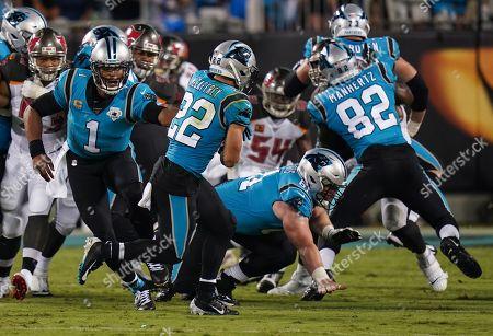 Cam Newton, Quarterback of the Carolina Panthers (1), hands the ball to Christian McCaffrey, Running Back of the Carolina Panthers (22)