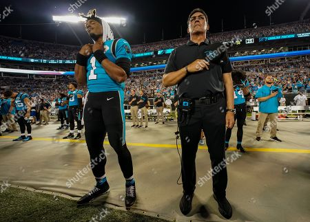 Cam Newton, Quarterback of the Carolina Panthers (1), stands alongside Carolina Panthers Head Coach Ron Rivera during the singing of the national anthem before kick-off