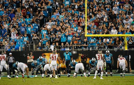 Cam Newton, Quarterback of the Carolina Panthers (1), sets up his offence