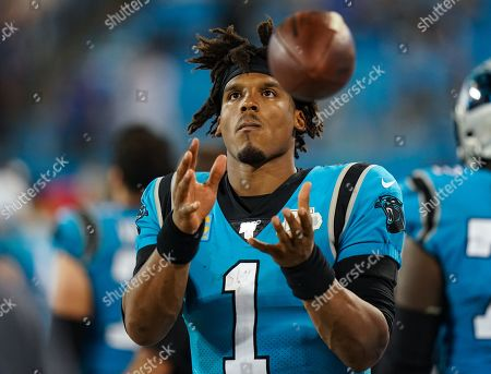 Cam Newton, Quarterback of the Carolina Panthers (1), catches the ball on the sideline