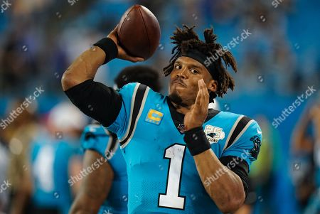 Cam Newton, Quarterback of the Carolina Panthers (1), throws the ball on the sideline