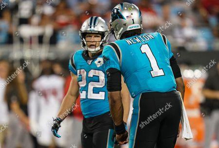 Cam Newton, Quarterback of the Carolina Panthers (1), talks to Christian McCaffrey, Running Back of the Carolina Panthers (22) on the field