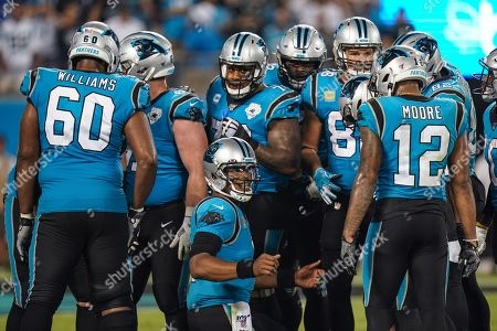 Cam Newton, Quarterback of the Carolina Panthers (1), talks to his offence on the field