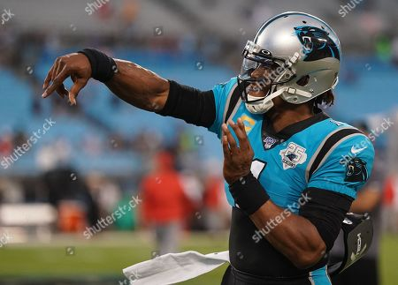 Stock Picture of Cam Newton, Quarterback of the Carolina Panthers (1), warms up on the field before kick-off