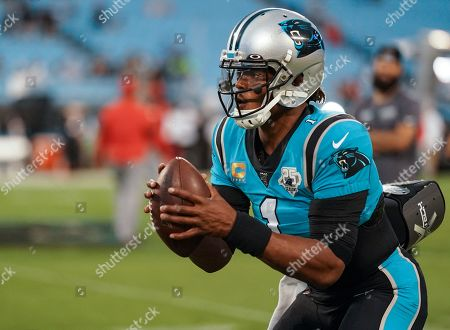 Stock Image of Cam Newton, Quarterback of the Carolina Panthers (1), warms up on the field before kick-off