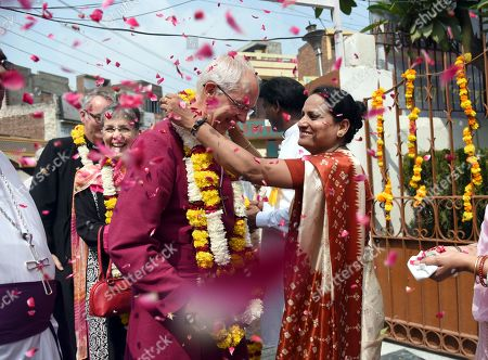 Archbishop of Canterbury Revd Justin Welby with his wife being welcomed during their visit, at Christ Church Cathedral, Ram Bagh