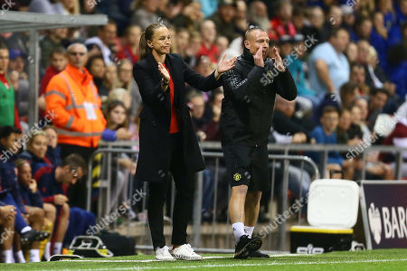 Casey Stoney, manager of Manchester United sarcastically applauds the referee