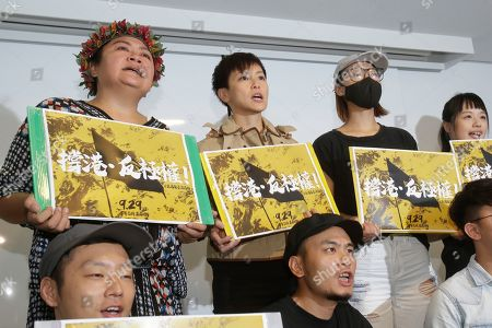"Hong Kong singer Denise Ho, center, shouts slogans calling on Taiwanese people to take part in the ""Hold Hong Kong, anti-totalitarian"" march on September 29 during a press event to support Hong Kong pro-democracy activity in Taipei, Taiwan"