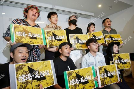 "Hong Kong singer Denise Ho, back, second from left, shoots slogans and calls on Taiwanese people to take part in the ""Hold Hong Kong, anti-totalitarian"" march on September 29 during a press event to support Hong Kong pro-democracy activity in Taipei, Taiwan"