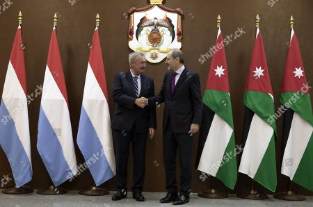 Luxembourg Foreign Minister Jean Asselborn (L) shakes hands with his Jordan counterpart Ayman Safadi at the Foreign Ministry in Amman, Jordan, 12 September 2019.