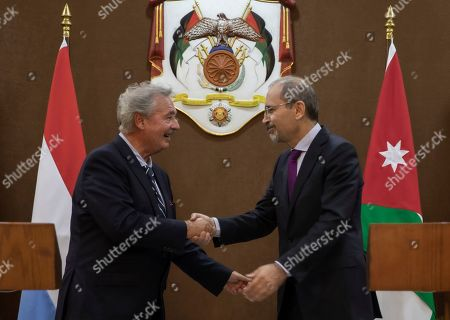 Jordan Foreign Minister Ayman Safadi with his Jordan counterpart Jean Asselborn (L) shake hands after addressimg the media at the Foreign Ministry in Amman, Jordan, 12 September 2019.