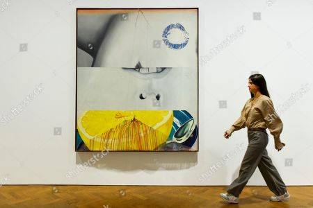 """A staff member walks by """"Morning Sung"""", 1963, at a preview of """"Visualising the Sixties"""", the first in depth exhibition of works by artist James Rosenquist.  From a painter of commercial billboards in New York City, to a fine art career as a Pop artist, Rosenquist's work was described as Andy Warhol's favourite.  The exhibition is on at Galerie Thaddaeus Ropac in Mayfair 10 September to 9 November."""