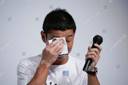 Zozo founder Yusaku Maezawa wipes his tears while speaking at a news conference, in Tokyo. Yahoo Japan Corp. said Thursday, Sept. 12, 2019 it will put up a tender offer, estimated at 400 billion yen ($3.7 billion), for Zozo Inc., a Japanese online retailer started by a celebrity tycoon