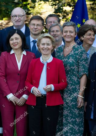 Incoming European Commission President Ursula von der Leyen, center front, stands with EU Commissioner designates during a group photo at a hotel at Genval, Belgium, . Front row left to right, European Commissioner designate for Values and Transparency Vera Jourova, European Commissioner designate for Europe fit for the Digital Age Margrethe Vestager and European Commissioner designate for Internal Market Sylvie Goulard