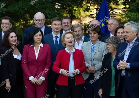 Incoming European Commission President Ursula von der Leyen, center front, stands with EU Commissioner designates during a group photo at a hotel at Genval, Belgium, . Front row left to right, European Commissioner designate for Equality Helena Dalli, European Commissioner designate for Values and Transparency Vera Jourova, European Commissioner designate for Internal Market Sylvie Goulard, European Commissioner designate for Cohesion and Reforms Elisa Ferreira and European Commissioner designate for Justice Didier Reynders
