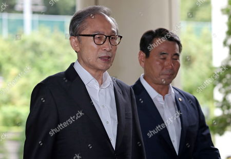 South Korea former president Lee Myung-bak (L) arrives at the Seoul Central District Court to attend a hearing in Seoul, South Korea, on 04 September 2019. Lee, who was freed on bail from a detention center on 06 March, is appealing a 15-year sentence for bribery, embezzlement and other acts of corruption.