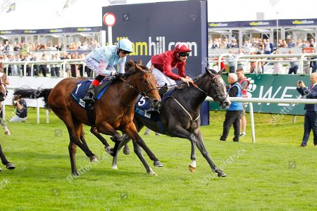 Graceful Magic and Charles Bishop [right] wins the British Stallion Studs EBF Carrie Red Fillies Nursery at Doncaster from Stylistique and Rosadora.