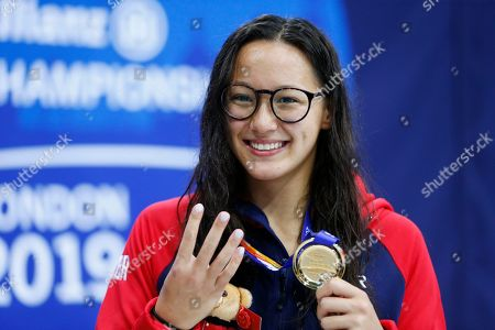 Alice Tai of Britain gestures with her gold medal for the Women's 400M Freestyle S8 final on day four of the World Para Swimming Championships at the London Aquatics Centre in London, Britain, 12 September 2019. The event is one of the largest Para Swimming championships and will see nearly 600 swimmers compete from 09 September to 15 September 2019.