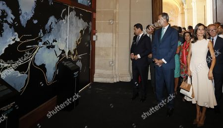 Spanish King Felipe VI of Spain (C) and Queen Letizia (R) attend the opening of the exhibition 'The Longest Journey' with acting deputy Prime Minister, Carmen Calvo (R), on occasion of the 5th Centenary of the First Travel Around the World at the Royal Alcazar of Seville, Spain, 12 September 2019.