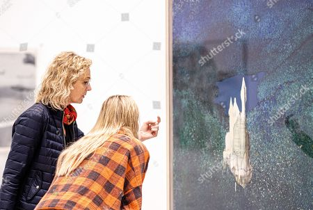 Stock Picture of Visitors look at the artwork 'Schloss Neuschwanstein' by Gerhard Richter in the exhibition 'Die jungen Jahre der alten Meister' (The Early Years of the Old Masters) in the Deichtorhallen venue in Hamburg, Germany, 12 September 2019. The exhibition featuring German famous painters Georg Baselitz, Gerhard Richter, Sigmar Polke, and Anselm Kiefer runs from 13 September to 05 January 2020.
