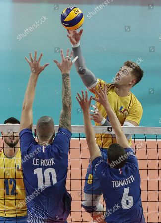 Stock Picture of Kevin Le Roux and Benjamin Toniutti (L) of France in action against Robert Adrian Aciobanitei (R) of Romania during the EuroVolley Men 2019 match between France and Romania in Montpellier, France, 12 September 2019.