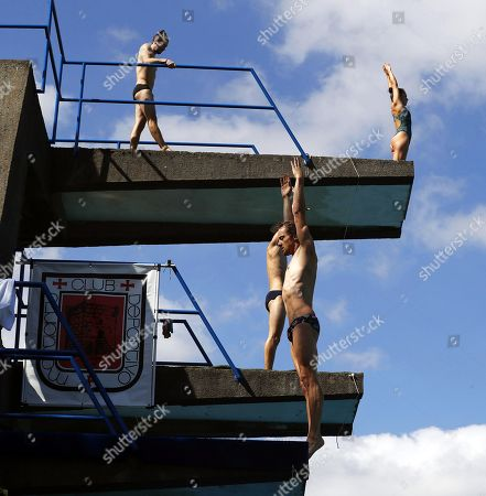 Britain's Gary Hunt (front) takes part in a training session for the Cliff Diving World Series final at the diving pool of Club Deportivo Martiartu in Erandio, near Bilbao, Spain, 12 September 2019. The Red Bull Cliff Diving World Series final, taking place on 13 and 14 September 2019, will be the first one permitting women to compete.