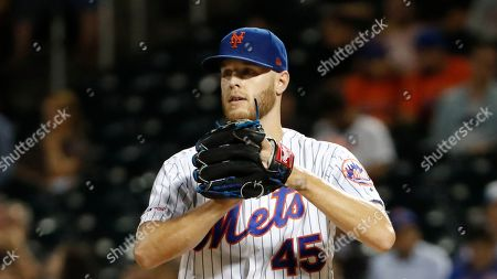 New York Mets' starting pitcher Zack Wheeler checks on a runner during a baseball game against the Arizona Diamondbacks, in New York