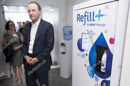 Nestle's CEO Ulf Mark Schneider pass next to a prototype of a refill machine for Nestle Pure Life water during the inauguration of Nestle Institute of Packaging Sciences at the Nestle Research center of the food and drinks giant, in Vers-chez-les-Blanc, Lausanne, Switzerland, 12 September 2019.