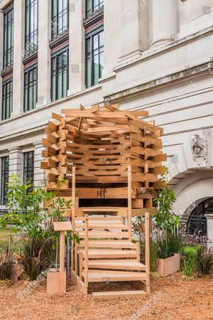 Sir John Sorrell CBE, Chairman of London Design Festival, commissioned Juliet Quintero of Dallas-Pierce-Quintero, to create a lookout seat for the garden. It is shaped like a bird's nest and will create a space for contemplation and reflection.  The planks of red oak were thermally modified to make the piece more durable for outdoor use and the piece was structurally engineered by Arup. Sir John invited leaders of London's cultural institutions to collaborate with some of Europe's most exciting designers to create a 'legacy' piece of design  in American red oak for London Design Festival. The pieces ' ten in total ' are on show in the Sculpture Gallery of the Victoria & Albert Museum, with only this one outside the Natural History Museum on Exhibition Road - they will be in place for the duration of London Design Festival, 14-22 September 2019. The project is in collaboration with the American Hardwood Export Council (AHEC).