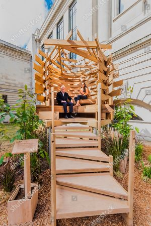 Stock Photo of Sir John Sorrell CBE, Chairman of London Design Festival, commissioned Juliet Quintero (both pictured) of Dallas-Pierce-Quintero, to create a lookout seat for the garden. It is shaped like a bird's nest and will create a space for contemplation and reflection. The planks of red oak were thermally modified to make the piece more durable for outdoor use and the piece was structurally engineered by Arup. Sir John invited leaders of London's cultural institutions to collaborate with some of Europe's most exciting designers to create a 'legacy' piece of design in American red oak for London Design Festival. The pieces ' ten in total ' are on show in the Sculpture Gallery of the Victoria & Albert Museum, with only this one outside the Natural History Museum on Exhibition Road - they will be in place for the duration of London Design Festival, 14-22 September 2019. The project is in collaboration with the American Hardwood Export Council (AHEC).