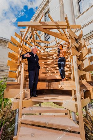 Stock Picture of Sir John Sorrell CBE, Chairman of London Design Festival, commissioned Juliet Quintero (both pictured) of Dallas-Pierce-Quintero, to create a lookout seat for the garden. It is shaped like a bird's nest and will create a space for contemplation and reflection. The planks of red oak were thermally modified to make the piece more durable for outdoor use and the piece was structurally engineered by Arup. Sir John invited leaders of London's cultural institutions to collaborate with some of Europe's most exciting designers to create a 'legacy' piece of design in American red oak for London Design Festival. The pieces ' ten in total ' are on show in the Sculpture Gallery of the Victoria & Albert Museum, with only this one outside the Natural History Museum on Exhibition Road - they will be in place for the duration of London Design Festival, 14-22 September 2019. The project is in collaboration with the American Hardwood Export Council (AHEC).