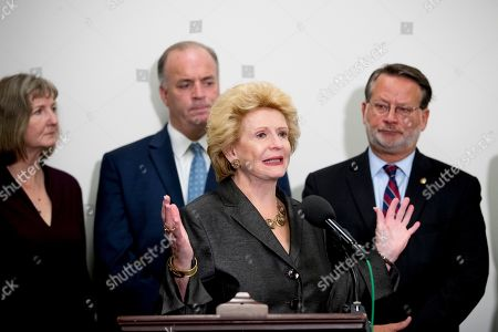 Stock Image of Debbie Stabenow, Dan Kildee, Gary Peters. Sen. Debbie Stabenow, D-Mich., center, accompanied by Rep. Dan Kildee, D-Mich., second from left, Sen. Gary Peters., D-Mich., right, and Elizabeth Whelan, the sister of Paul Whelan, left, speaks at a news conference on Capitol Hill in Washington, to call on Congress to pass a resolution condemning the Russian government for detaining Paul Whelan
