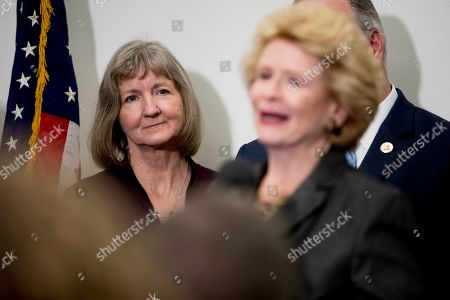 Stock Photo of Debbie Stabenow, Elizabeth Whelan. Elizabeth Whelan, the sister of Paul Whelan, left, listens as Sen. Debbie Stabenow, D-Mich., right, speaks at a news conference on Capitol Hill in Washington, to call on Congress to pass a resolution condemning the Russian government for detaining Paul Whelan