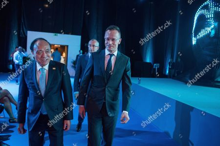 Secretary General of the International Telecommunication Union (ITU) Houlin Zhao (L) of China and Hungarian Minister of Foreign Affairs and Trade Peter Szijjarto (R) arrive for the closing session of the ITU Telecom World 2019 conference in Hungexpo Fair Centre in Budapest, Hungary, 12 September 2019. The four-day conference and exhibition was a global platform for high-level debate, networking, innovation-showcasing and knowledge-sharing across the information and communications technology community.