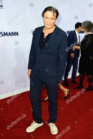 German actor Oliver Masucci attends the red carpet of the Bertelsmann party 2019 in Berlin, Germany, 12 September 2019. More than 600 guests from all fields of society are invited for the Bertelsmann Party 2019.