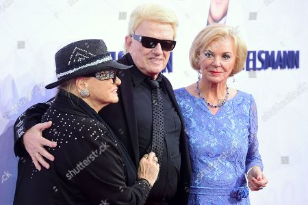 Stock Image of German musician Heinz Georg Kramm (C) and his wife Hannelore Kramm (L) and German businesswoman and philanthropist Liz Mohn (R) attend the red carpet of the Bertelsmann party 2019 in Berlin, Germany, 12 September 2019. More than 600 guests from all fields of society are invited for the Bertelsmann Party 2019.