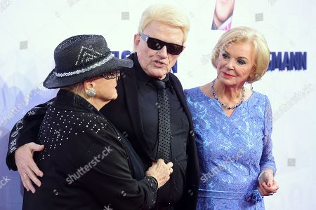 Stock Picture of German musician Heinz Georg Kramm (C) and his wife Hannelore Kramm (L) and German businesswoman and philanthropist Liz Mohn (R) attend the red carpet of the Bertelsmann party 2019 in Berlin, Germany, 12 September 2019. More than 600 guests from all fields of society are invited for the Bertelsmann Party 2019.